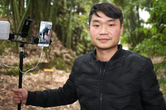 Farmer Liu Jin Ying croons into a makeshift microphone during a livestream for viewers from all over China.
