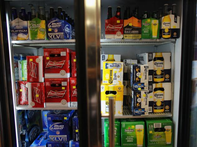 A fridge holds Anheuser-Busch's Budweiser and Grupo Modelo's Corona Light beers. Lawmakers are touting craft breweries as the winners from the tax cuts, but public health officials are concerned about lost tax revenues and rising public costs.