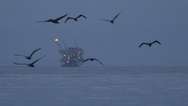 An oil platform sits in the distance at Refugio State Beach in California in 2015. Now that the Trump administration has announced plans to allow new oil and gas drilling leases in more federal waters, a number of states are petitioning to be exempt from
