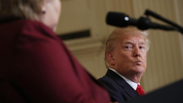 President Trump listens as Norwegian Prime Minister Erna Solberg speaks at a joint news conference Wednesday. At an Oval Office meeting on immigration policy, Trump said the U.S. should want more people from countries like Norway, disparaging Haiti and w