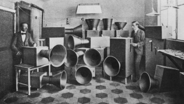 "The futurist artist Luigi Russolo (left)  with his noise machine, invented for futurist ""symphonies,"" one of which was performed at the London Coliseum in June 1914."