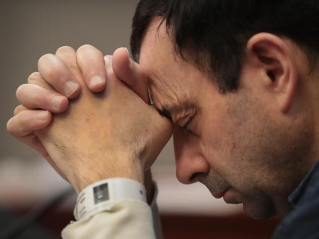 Larry Nassar listens to victim impact statements prior to being sentenced after being accused of molesting more than 140 women and girls while he was a physician for Team USA and Michigan State University. Nassar has pleaded guilty in Ingham County, Mich