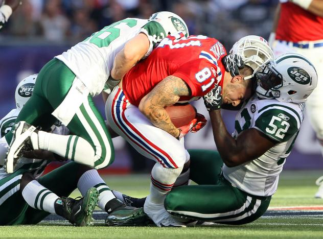 Aaron Hernandez (81), of the New England Patriots, lost his helmet during this play against the New York Jets in 2011. Hernandez killed himself in 2017, and researchers found that he had had one of the most severe cases of CTE ever seen in someone his ag