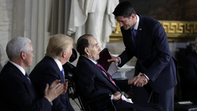 President Donald Trump and Vice President Mike Pence watch as House Speaker Paul Ryan of Wis., greets former Sen. Bob Dole during a Congressional Gold Medal ceremony honoring Dole on Capitol Hill Wednesday.