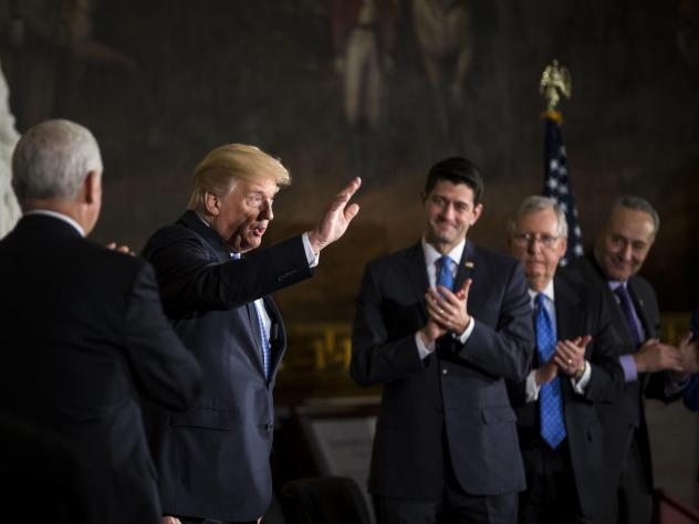 President Trump with congressional leaders on Wednesday during a Congressional Gold Medal ceremony for former Senate Majority Leader Bob Dole at the U.S. Capitol. Thursday, Trump scrambled efforts to negotiate a spending deal with a morning tweet.