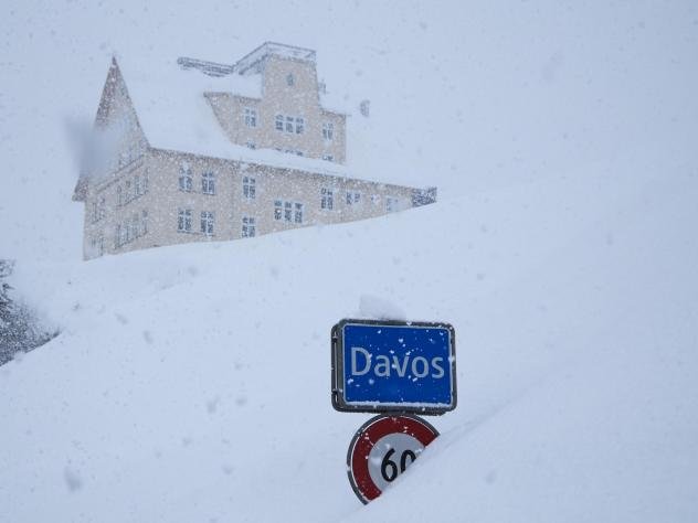 The town sign stands in the snow at the entrance to Davos, Switzerland, host to the 48th annual meeting of the World Economic Forum taking place this week. Donald Trump will be among the attendees.