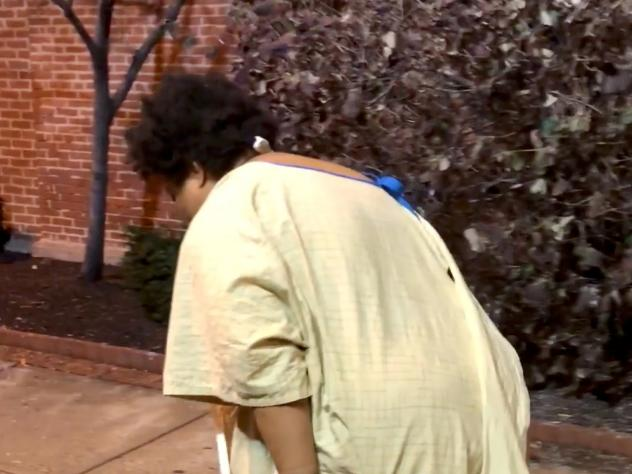 A woman discharged from a Baltimore hospital, later identified as Rebecca, was captured on video by passerby Imamu Baraka.