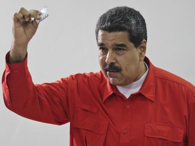 Venezuela's President Nicolás Maduro shows his ballot after casting a vote in 2017 for a constitutional assembly in Caracas, Venezuela.