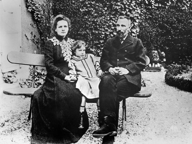 Marie Curie holds her daughter, Irene, for a photo in 1904 with husband Pierre in the garden of the Sevres Office of Weights and Measures in Sevres, France.