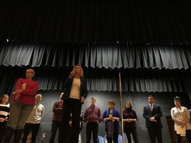 Democratic gubernatorial candidate Andy McGuire pitches herself to caucus-goers in the Roosevelt High School Auditorium in Des Moines during the Iowa Caucuses on Feb. 5, 2018.