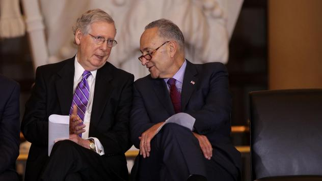 U.S. Senate Majority Leader Mitch McConnell (left) chats with Senate Minority Leader Chuck Schumer in October. The two negotiated a budget agreement that marks a major breakthrough for a Congress still reeling from a partial government shutdown last mont