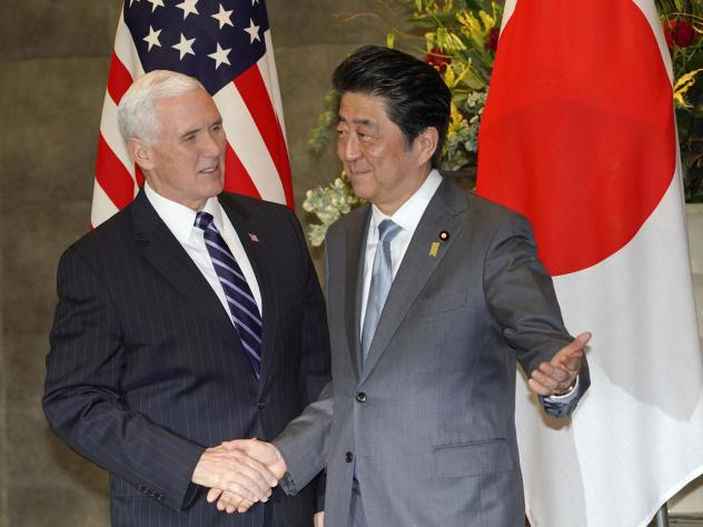 Vice President Mike Pence is greeted by Japanese Prime Minister Shinzo Abe in Tokyo on Wednesday.