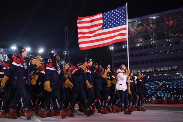 The United States team walks in the Parade of Athletes during the Winter Olympics opening ceremony on Friday. The team has more athletes than any nation at the Games and it's the most diverse of any U.S. winter squad, in terms of both race and gender. Th