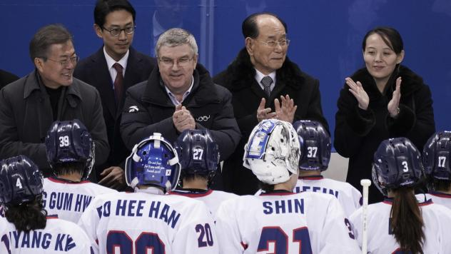 Kim Yo Jong has captured attention during her visit to the Pyeongchang Winter Olympics. Here, South Korea's President Moon Jae-in speaks to Kim as International Olympic Committee President Thomas Bach looks on, at the first game of the unified Korean wom