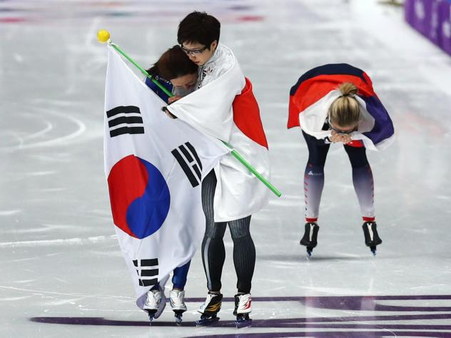 Nao Kodaira of Japan hugs Sang-Hwa Lee of Korea after Kodaira beat Lee in the 500m speed skating finals. The two have finished within fractions of a second of each other for years and are constantly compared to one another.