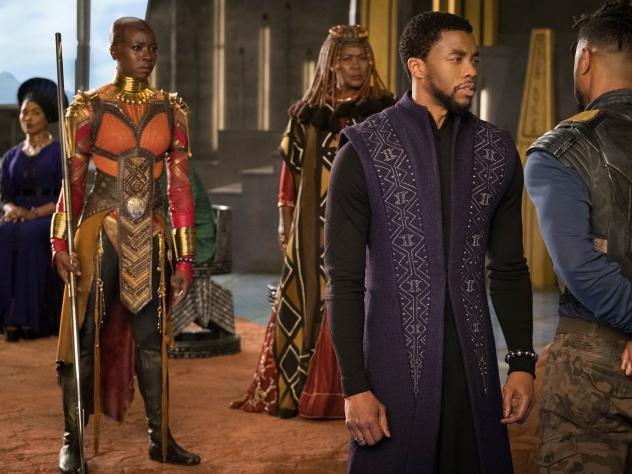 A scene from Black<em> Panther.</em> The titular hero, played by Chadwick Boseman, is on the right.