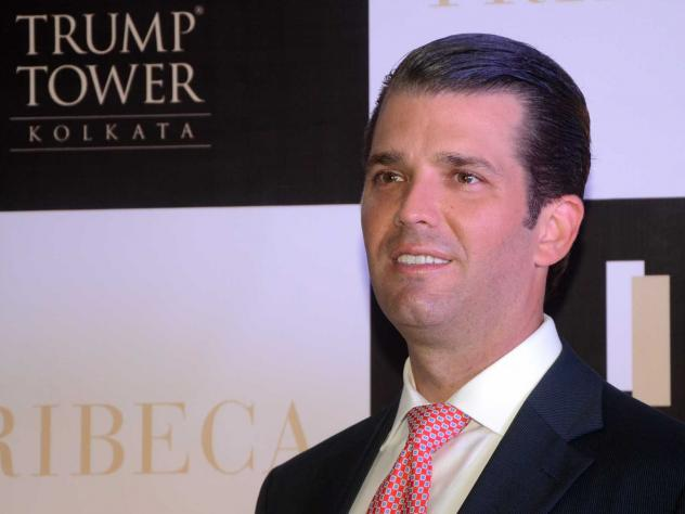 "Donald Trump Jr. at a photo session after visiting Trump Tower Kolkata, a Trump Organization apartment building in India. Its website says it is ""synonymous with celebrated luxury."""