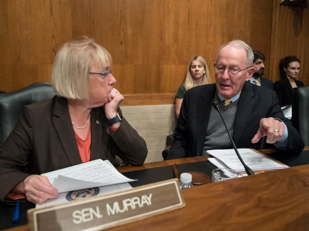 Sen. Patty Murray, D-Wash., the ranking member, and Sen. Lamar Alexander, R-Tenn., chairman of the Senate Health, Education, Labor, and Pensions Committee, meet before the start of a hearing on Capitol Hill in Washington, Wednesday, Oct. 18, 2017, the mo