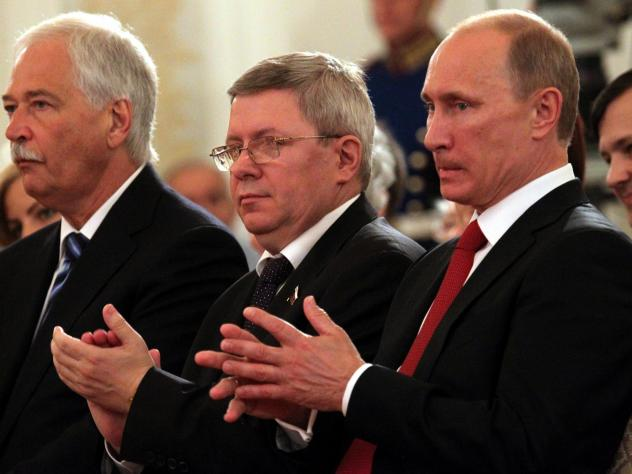Russian politician Alexander Torshin, standing next to then-Russian prime minister Vladimir Putin, attends a ceremony at the Kremlin in 2011. Torshin is a lifetime member of the National Rifle Association, and says he met Donald Trump through the group i