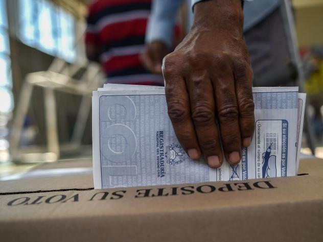 A man casts his vote at a polling station in Cali, Valle del Cauca Department, during parliamentary elections in Colombia on March 11. The elections are the first that FARC will partake in as a legal political party. (Luis Robayo/AFP/Getty Images)