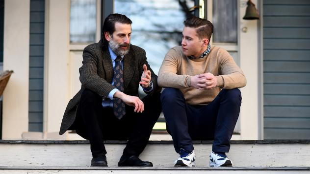 Dr. Lee Goldstein, Associate Professor of Psychiatry, Neurology, Ophthalmology, Pathology and Laboratory Medicine, & Biomedical Engineering at Boston University and Newton North High School Football player Alex Riviero speak on the front porch of Dr. Gol