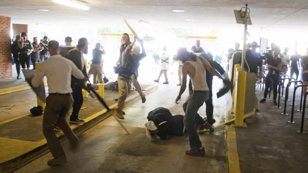 DeAndre Harris, seen balled on the ground, suffers a beating in a parking garage near the Charlottesville police station after the white nationalist rally last August.
