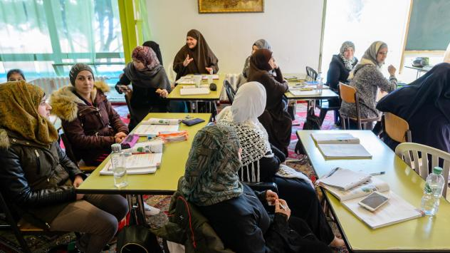 Muslim women from Syria take a German language lesson at a Muslim cultural center in February in Halle, Germany.