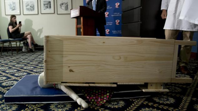 A child-size dummy is crushed by a dresser during a Consumer Product Safety Commission news conference in Washington, D.C., in 2016. That year Ikea began a recall of millions of dressers after six children were killed in tip-over incidents. But a new stu