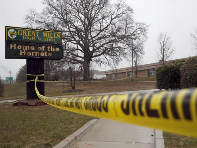 A photo from Tuesday, March 20, shows crime scene tape around Great Mills High School, the scene of a shooting in Great Mills, Md.