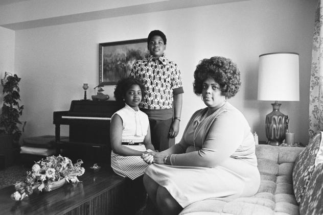 In this April 30, 1974, file photo, Linda Brown, right, and her two children pose for a photo in their home in Topeka, Kan. Brown, the Kansas girl at the center of the 1954 U.S. Supreme Court ruling that struck down racial segregation in schools, died Ma