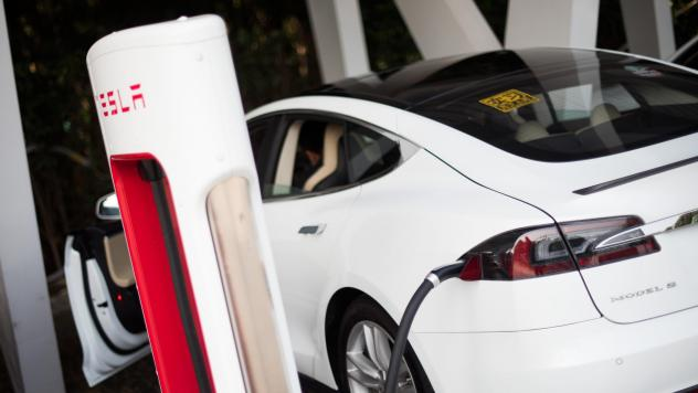 A Tesla Model S electric vehicle is charged at a car dealership in Shanghai, China, in March 2015.