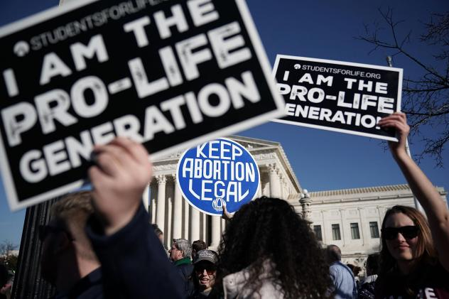 A protester holds up a sign at the March for Our Lives rally in Washington, D.C. on March 24, 2018.