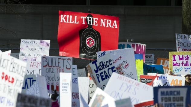Protesters hold signs aloft as they attend the March for Our Lives rally in support of gun control in Washington, D.C., last month.