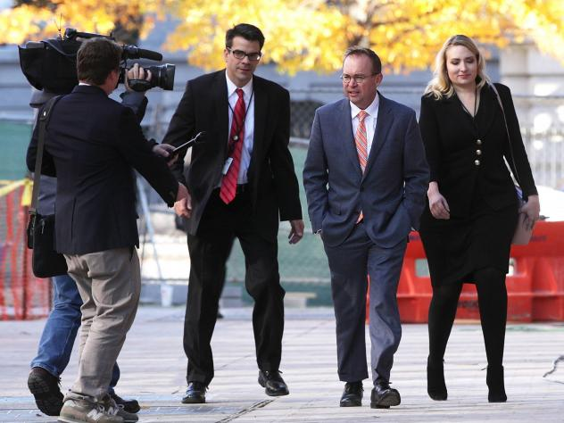 Mick Mulvaney arrives at the Consumer Financial Protection Bureau on Nov. 27, 2017, after being named director by President Trump. Mulvaney's appointment is being challenged in court by Leandra English, who had been appointed to that position by outgoing