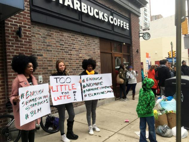 Protesters gather outside a Starbucks in Philadelphia, Sunday, April 15, 2018, where two black men were arrested Thursday after Starbucks employees called police to say the men were trespassing. The arrest prompted accusations of racism on social media.