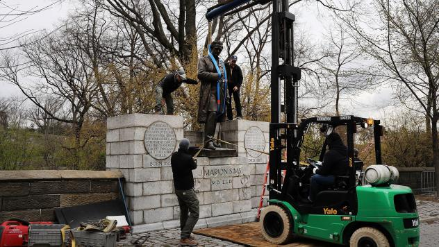 The statue, shown being driven away in a Parks Department truck on Tuesday, will be relocated in Green-Wood Cemetery in Brooklyn, where Sims is buried.