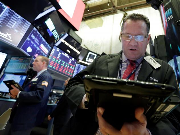 Trader Edward Curran (right) works on the floor of the New York Stock Exchange on Monday. As Treasury yields topped 3 percent on Tuesday, the Dow Jones industrial average tumbled.
