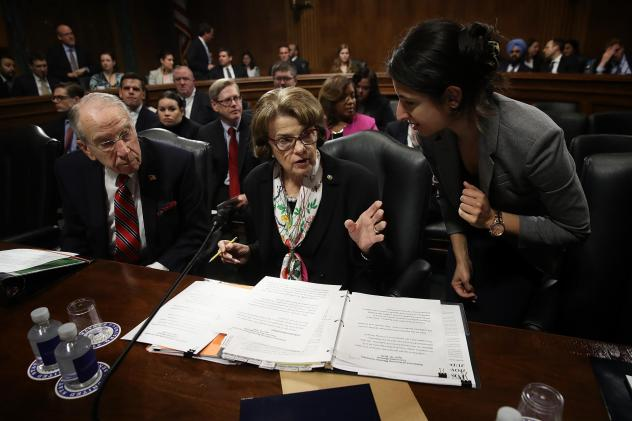 Senate Judiciary Committee Chairman Chuck Grassley confers with ranking member Dianne Feinstein at a committee hearing on April 19. The committee has approved legislation to protect special counsel Robert Mueller's investigation.