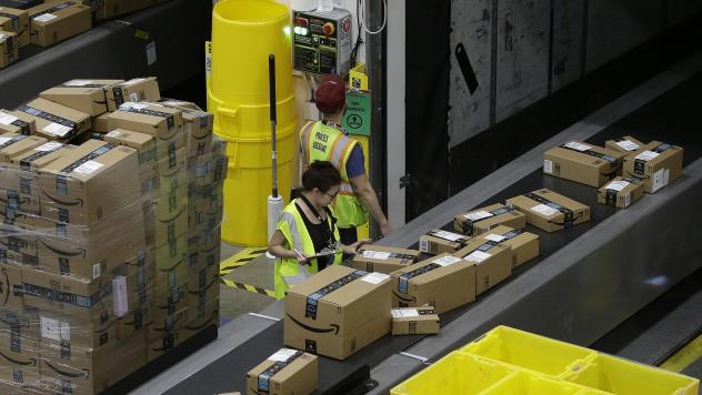 Packages move down a conveyor system to the proper shipping area at the new Amazon Fulfillment Center in Sacramento, Calif., on Feb. 9. Amazon's profits, announced on Thursday, roughly tripled what analysts had been expecting.