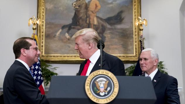 President Trump shakes hands with Health and Human Services Secretary Alex Azar  after he is sworn in by Vice President Pence on Jan. 29. Major reproductive health organizations are voicing concerns about the Trump administration's new approach to federa