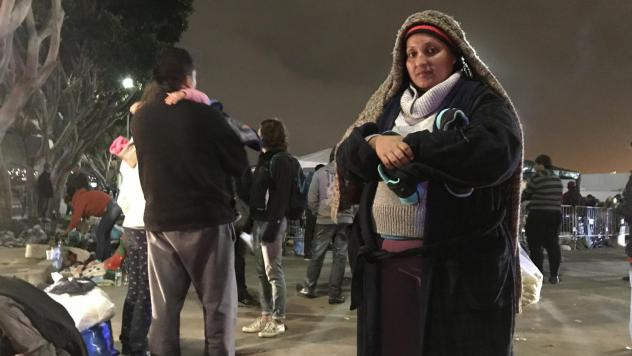 Volunteers pass out food and hot cocoa for migrants camped outside the U.S. port of entry in Tijuana.