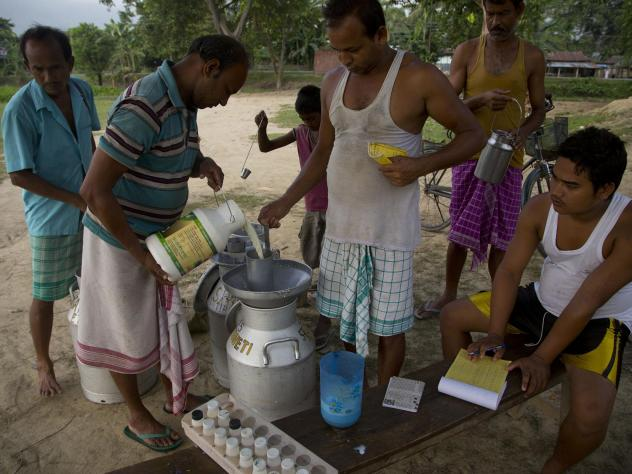 A man pours milk into a can in India's Mayong village in 2015. India is the world's largest producer and consumer of milk.