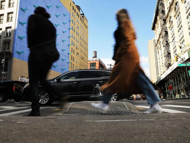 Pedestrians walk along a Manhattan street in New York City in March. A new report finds that SUVs are increasingly involved in fatal crashes with pedestrians.