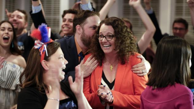 Kara Eastman, winner of the Nebraska 2nd Congressional District primary Tuesday, is hugged by her campaign manager Ben Onkka, in Omaha, Neb.