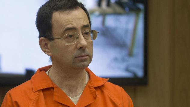 Former Michigan State University and USA Gymnastics doctor Larry Nassar appears at a sentencing hearing on Feb. 5, in Charlotte, Mich. On Wednesday, MSU announced a $500 million settlement with hundreds of women and girls who say Nassar abused them.