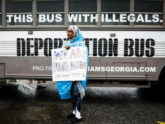 "Protesters gather outside state senator and gubernatorial candidate Michael Williams's ""Deportation Bus"" in Clarkston, Ga."