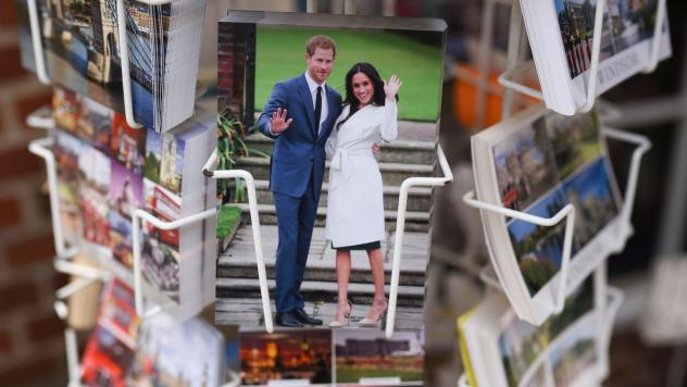 Prince Harry and Meghan Markle greet tourists from the glossy surface of a postcard sold Friday in Windsor. The pair — the real people, not their images, we mean — will wed at St. George's Chapel in Windsor Castle on Saturday.
