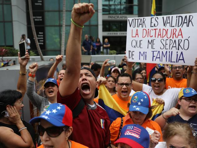 Marcos Carbono (center) joins a protest against the weekend's election in Venezuela in front of that country's consulate in Miami. President Nicolás Maduro may have won the vote count but in the process lost the legitimacy to govern, one expert writes.