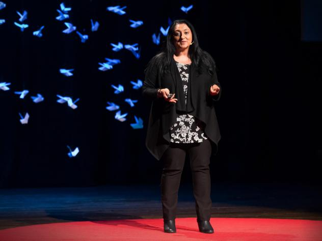 Amishi Jha on the TED stage.