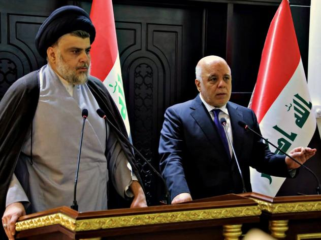 In this photo provided by the Iraqi government, Iraqi Prime Minister Haider al-Abadi (right) and Shiite cleric Muqtada al-Sadr hold a press conference in Baghdad on May 20. Sadr's coalition won the largest number of seats in Iraq's parliamentary election